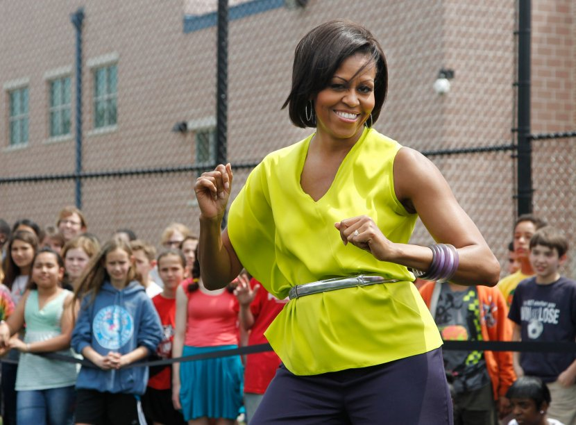 First lady Michelle Obama dances with students at Alice Deal Middle School in northwest Washington, Tuesday, May 3, 2011, during a surprise visit for the school's Let's Move! event.    (AP Photo/Manuel Balce Ceneta)